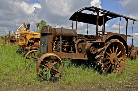 lugs: BARNESVILLE, MINNESOTA, September, 14, 2014: The old rusty Hart-Parr  tractor comes from Hart-Parr Tractor Company which began operations in 1897 and sold out to Oliver Tractor company in 1929.