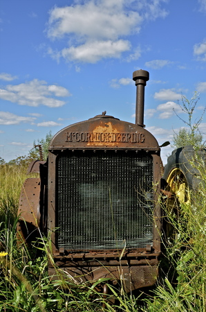 BARNSEVILLE, MINNESOTA, Sept 14,2014:The old rusty tractor grill bears the McCormick Deering logo which became a trademark name of a line of tractors and farm machinery manufactured by the International Harvester Co.