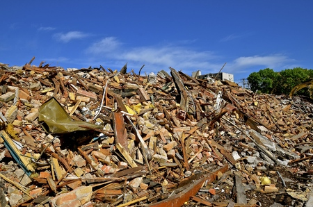 The demolition of an old brick building leaves a huge pile of rubbish. Stock Photo