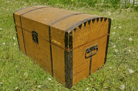 Very old wooden steamer trunk built in the late 1800s used to transport personal items to the USA from a Scandinavian country