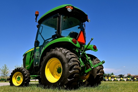 MOORHEAD, MINNESOTA, May 31, 2015: The new John Deere 3046R tractor is a product of the John Deere Co, an American corporation that manufactures agricultural, construction, forestry machinery, diesel engines, and drivetrains. Editorial