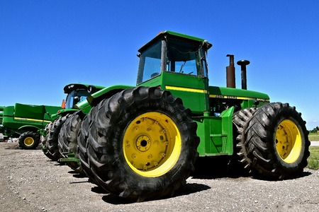 MOORHEAD, MINNESOTA, May 31, 2015: The new John Deere 8440 tractor is a product of the John Deere Co, an American corporation that manufactures agricultural, construction, forestry machinery, diesel engines, and drivetrains. Editorial