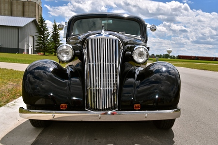MOORHEAD, MINNESOTA, June 15, 2017: The black 1937 Chevrolet car is a Chevrolet, colloquially referred to as Chevy and formally the Chevrolet Division of General Motors Company, is an American automobile division of the American manufacturer.