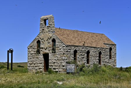 A very old stone block church stands empty on the South Dakota Prairies.
