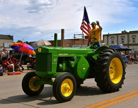 MANDAN, NORTH DAKOTA, July 3, 2017: The 4th of July Rodeo Days 3 day celebration includes the rodeo, Art in the Park, and downtown parade where this John Deer two cylinder 80 tractor is displayed Editorial