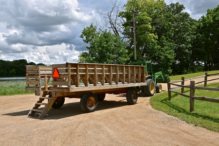 hauler: A wagon known as a (people hauler) is hooked to a tractor and is empty of passengers