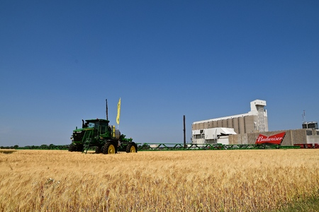 MOORHEAD, MINNESOta, July 22, 2017: Anheuser-Busch sponsored Grower Days honoring farming who grow barley for the malting process which included a huge John Deere sprayer displayed in the wheat field in front of the malting plant