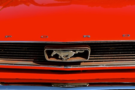 WEST FARGO, NORTH DAKOTA, July 20, 2017: The West Fargo Cruise night occurs each 3rd Thursday night in the summer months and features classic cars such as this mustang and Ford logo of a 1960s Mustang.