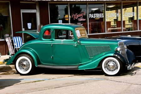 restored: CASSELTON, NORTH DAKOTA, July 27, 2017: The annual Casselton Car Show which occurs the last Thursday of July features classic vehicles such as the 1934 restored five window and  two door Ford Coupe