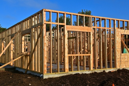 New construction of an office building being framed and built on a concrete pad. Stock Photo