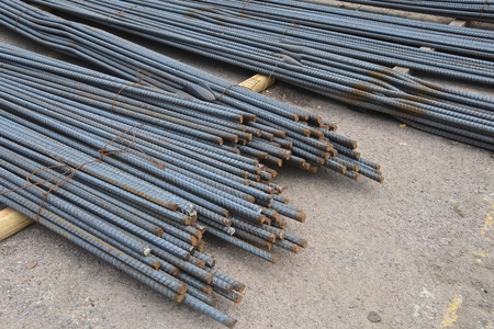 ironworks: Piles of rebar and reinforcing rod used for a construction project in strengthening concrete Stock Photo