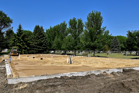 rafters: The foundation and footing for a new building under construction.