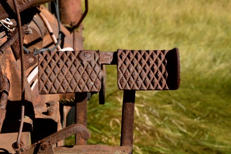 Rusty old foot brake pedals of a tractor Stock Photo