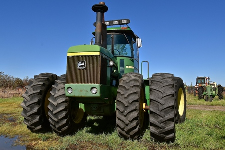 DOWNER, MINNESOTA, September 17, 2017: :The John Deere 8460 tractor with a cab is a  product of John Deere Co, an American corporation that manufactures agricultural, construction, forestry machinery, diesel engines, and drivetrains.