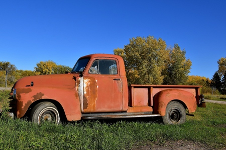 DOWNER, MINNESOTA, October 4, 2017: The old rusty 40s pickup colloquially referred to as Chevy and formally the Chevrolet Division of General Motors Company, is an American automobile division of the American manufacturer