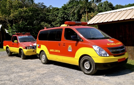 ROATAN, HONUuRAS, February 18, 2017: The red and yellow vehicle is the emergency ambulance use as the Run For Fun Cruise Jungle Run provided by the local community. Sajtókép
