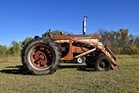 PELICAN RAPIDS, OCTOBER 3, 2017: The old 706 Farmall tractor pulling a field cultivator was a model name and later a brand name for tractors manufactured by the American company International Harvester IH