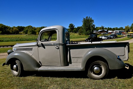 DALTON, MINNESOTA, Sept 8 2017: An old restored Ford pickup is parked near the railroad tracks at the annual Dalton Steam Threshers Reunion held the 2nd weekend of September when 1,000s attend. Editorial