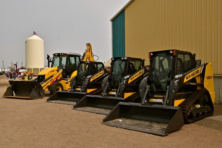 WEST FARGO, NORTH DAKOTA, September 21, 2017:  Displayed at the Big Iron show in West Fargo, North Dakota are a row of New Holland skid steers, held annually at the Red River Fairgrounds each September. Editorial