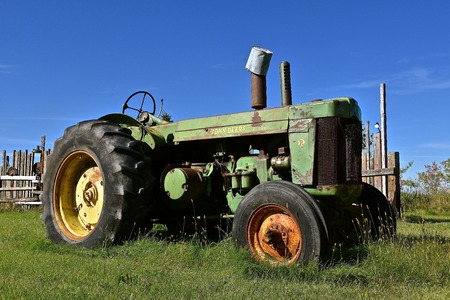 DOWNER, MINNESOTA, Oct 3, 2017:  The old John Deer R tractor is a product of John Deere Co, an American corporation that manufactures agricultural, construction, forestry machinery, diesel engines, and drivetrains Editorial