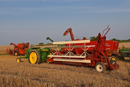 ROLLAG, MINNESOTA, Sept 2. 2017: An old John Deere tractor pulling a swather are to be used in field demonstrations at the annual WCSTR farm show in Rollag held each Labor Day weekend where 1000s attend.