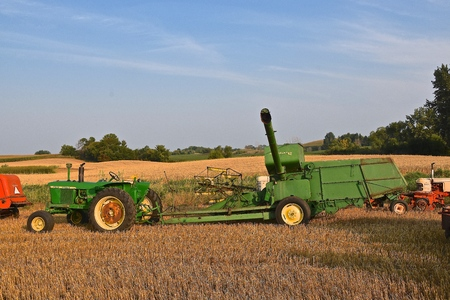 ROLLAG, MINNESOTA, Sept 2. 2017: An old John Deere 3010 tractor pulling a combine is to be used in field demonstrations at the annual WCSTR farm show in Rollag held each Labor Day weekend where 1000s attend.