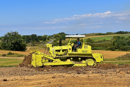 ROLLAG, MINNESOTA, Sept 3. 2017: The Euclid T-12 restored bulldozer moves earth at the annual WCSTR farm show in Rollag held each Labor Day weekend where 1000s attend.