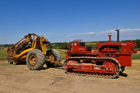 ROLLAG, MINNESOTA, Sept 3. 2017: An International Turbo red restored bulldozer pulls an earth scraper at the annual WCSTR farm show in Rollag held each Labor Day weekend where 1000s attend.
