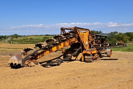 An antique trencher for digging trenches deep into the ground. Stock Photo - 92207640