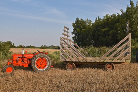 ROLLAG, MINNESOTA, Sept 3. 2017: A restored Case tractor pulling a straw rack for hauling bundles is ready for  field demonstrations at the annual WCSTR farm show in Rollag held each Labor Day weekend where 1000s attend.