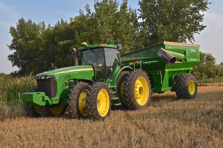 ROLLAG, MINNESOTA, Sept 1, 2017: A new 8420 John Deere tractor and grain cart are ready for demonstrations at the annual WCSTR farm show in Rollag held each Labor Day weekend where 1000s attend.