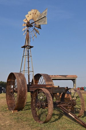 ROLLAG, MINNESOTA, Sept 1, 2017: A Monitor wind mill and Gas Traction wagon are displayed at the annual WCSTR farm show in Rollag held each Labor Day weekend where 1000's attend.