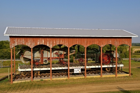 ROLLAG, MINNESOTA, Sept 1, 2017: An open sided shed storing a J.I. Case steam engine and threshing machine is a focal point at the annual WCSTR farm show in Rollag held each Labor Day weekend where 1000s attend. Editorial
