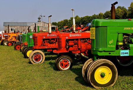 ROLLAG, MINNESOTA, Sept 3. 2017: A row of various tractors models  are displayed at the annual WCSTR farm show in Rollag held each Labor Day weekend where 1000s attend.