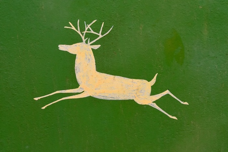 ROLLAG, MINNESOTA, September 2, 2017: A hand painted deer  appears on a machinery item displayed at the annual WCSTR farm show in Rollag held each Labor Day weekend where 1000s attend.