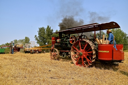 ROLLAG, MINNESOTA, Sept 4 2017: A  Minneapolis steam engine powers a threshing machine at the the annual WCSTR farm show in Rollag held each Labor Day weekend where 1000s attend.