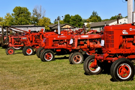 DALTON, MINNESOTA, Sept 8, 2017: A collection of Farmall tractor models are displayed at the annual Dalton Threshing Bee farm show in Dalton held each 2nd full weekend in September where 1000`s attend. Editorial
