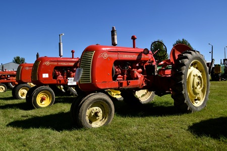 DALTON, MN, Sept 10, 2015:A row of restored Cockshutt tractors are displayed at the Dalton Steam Threshers Reunion where 1000s attend each Labor Day weekend in Dalton, MN each year. Editorial