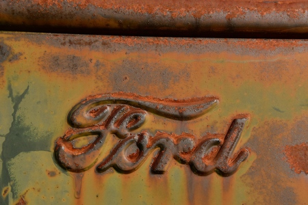 EAST GRAND FORKS, MINNESOTA, October 7, 2017: The rusty Ford  truck hood logo is a product of the Ford Motor Company located in Dearborn, Michigan started by Henry Ford and incorporated on June 16, 19