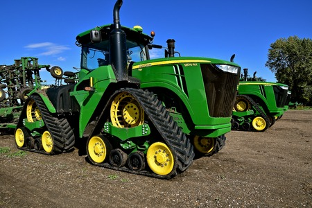 HAWLEY, MINNESOTA, September 25, 2017:  The 9570 RX tractors with triangular tracks are products of John Deere Co, an American corporation that manufactures agricultural, construction, forestry machinery, diesel engines, and drive trains