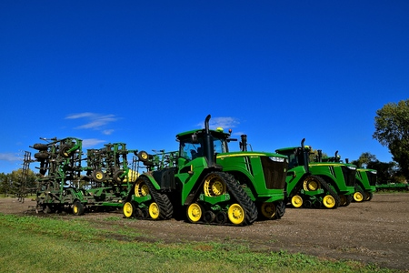 HAWLEY, MINNESOTA, September 25, 2017:  The 9570 RX tractors with triangular tracks and field cultivators are products of John Deere Co, an American corporation that manufactures agricultural, construction, forestry machinery, diesel engines, and drive tr Editorial