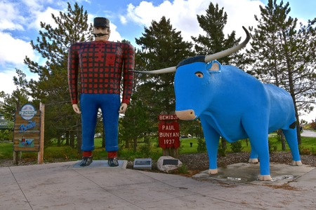 BEMIDJI, MINNESOTA, October 1, 2017: The legendary Paul Bunyan  and Babe the Blue Ox statues are tourist attractions run by the parks system of Bemidji, Minnesota.