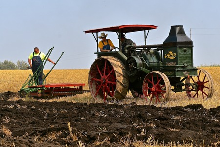 ROLLAG, MINNESOTA, Sept 2, 2017: A Rumely Oil Pull steam engine demonstrates gan plowing at the annual WCSTR farm show in Rollag held each Labor Day weekend where 1000s attend.