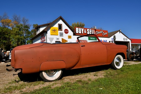 LAKE PARK, MINNESOTA, September 26, 2017:  The partially refurbished 54 Chevrolet convertible colloquially referred to as a Chevy and formally the Chevrolet Division of General Motors Company, is an American automobile division of the American manufactur