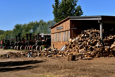 A huge shed full of firewood is available for the firing up of the line of old steam engines. Stock Photo