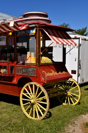 DALTON, MINNESOTA, Sept 8, 2017: Popcorn is for sale in an old decorated wood wheel coach located at the annual Dalton Threshing Bee farm show in Dalton held each 2nd full weekend in September where 1000s attend.
