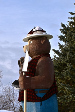 INTERNATIONAL FALLS, MINNESOTA, January 19, 2017:  Smokey the Bears, holding a shovel is a symbol of forest fire prevention throughout the United States  managed by the Forest Service.