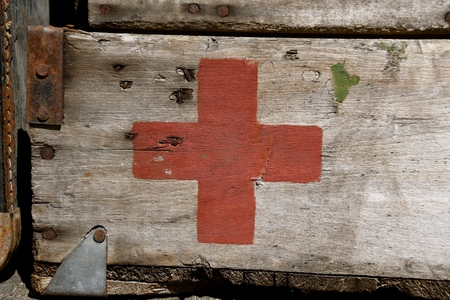 DALTON, MINNESOTA, Sept 8, 2017: A stenciled logo of the Red Cross on an old first aid box is displayed at the annual Dalton Threshing Bee farm show in Dalton held each 2nd full weekend in September where 1000's attend. Stock Photo