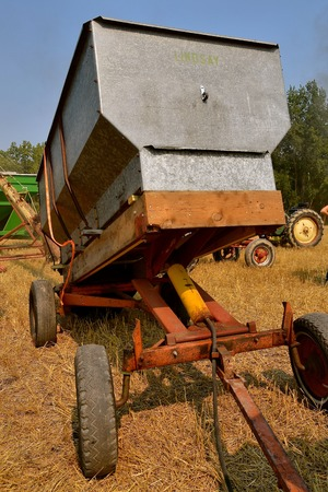 A vintage grain wagon with an hydraulic lift allowing gravity to assist in unloading Stock Photo