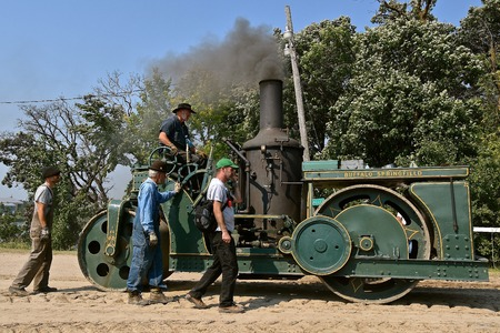 ROLLAG, MINNESOTA, Sept 2, 2017: The crew of the Buffalo Springfield steam engine participate in the  daily parade at the annual WCSTR farm show in Rollag held each Labor Day weekend Editorial
